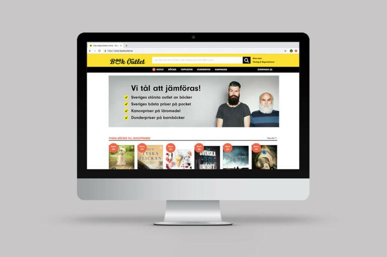 Dator med Book Outlets hemsida