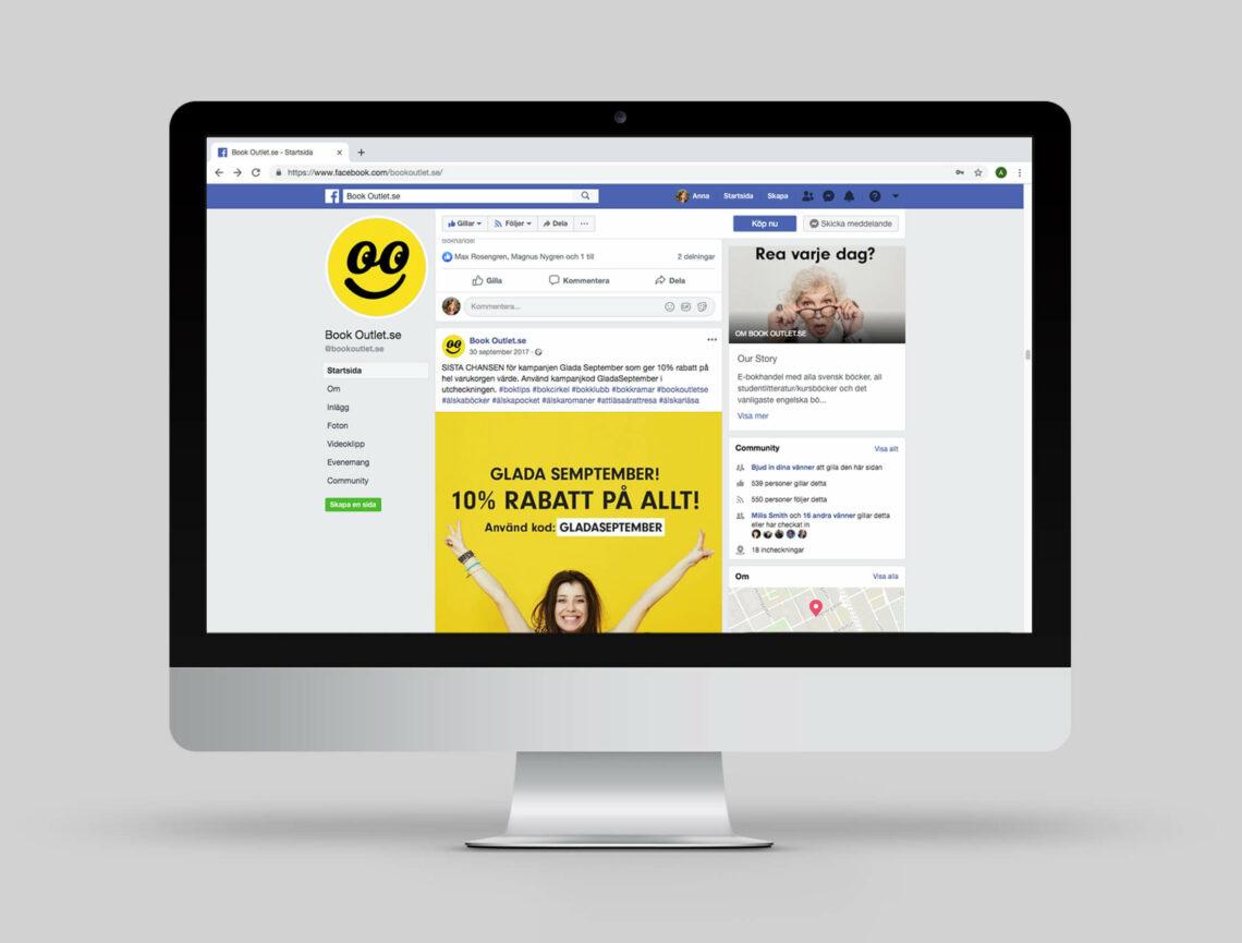 Dator med Book Outlets Facebook-sida