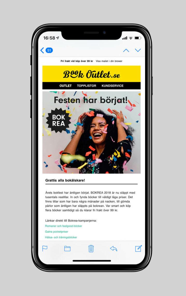 En mobilskärm med annons för bokrea i Book Outlets nyhetsbrev